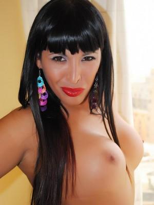 Slutty brunette shelesbian Augustina Gonzaga strips naked